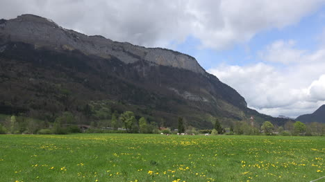 France-Meadow-And-Mountain-With-Clouds