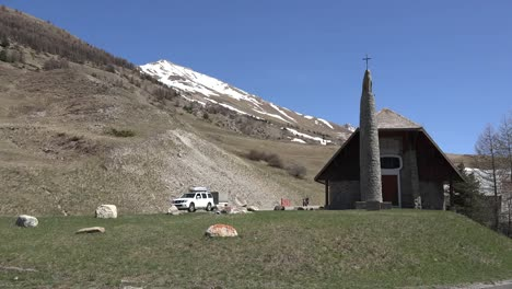 France-Motorcycle-Goes-By-Church-En-Route-From-The-Col-De-Larche