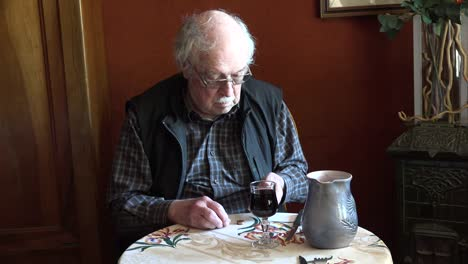 France-Old-Man-With-Glass-Of-Wine-Counting-Money