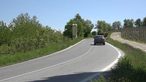 Italy-Cars-On-A-Curved-Road