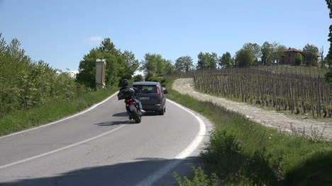 Italy-Motorcycles-Pass-Car-On-A-Curve-With-Sound