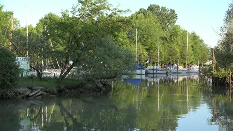 Italy-Sailboats-Moored-On-Stella-River