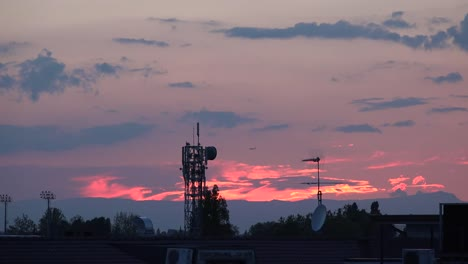 Italy-Sunset-With-Telecommunications-Device-And-Plane-Zoom-In
