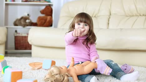 Baby-Girl-Playing-With-Doll