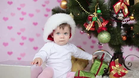 Baby-Girl-Prepares-The-Gifts-Near-The-Christmas-Tree