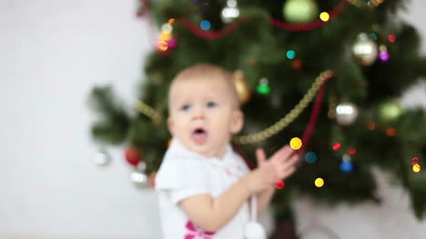 Baby-Girl-Yawns-Beside-The-Christmas-Tree