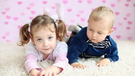 Brother-And-Sister-Lying-On-The-Floor-And-Looking-At-Camera-01