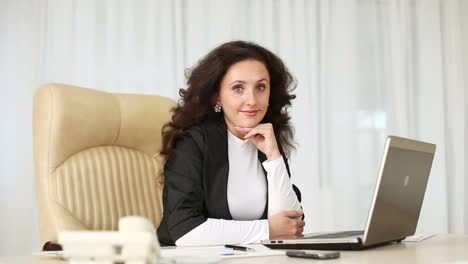 Business-Woman-Sitting-At-Table-And-Smiling-Dolly-Hd
