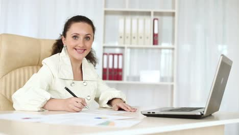 Business-Woman-Working-With-Documents-Near-Laptop-Dolly-Hd