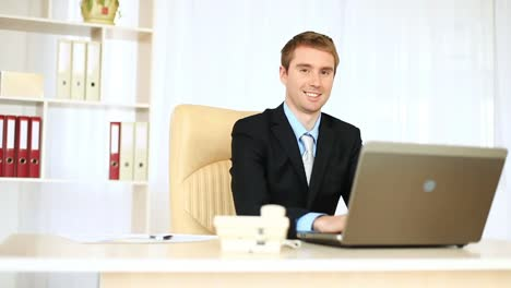 Businessman-Working-In-Office-Looking-At-Camera-Dolly-Hd