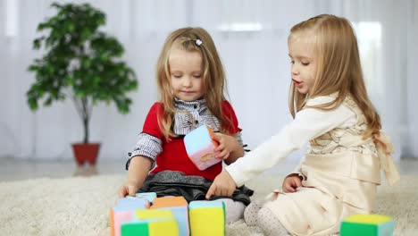 Children-Play-With-Blocks-Of-Tissue-They-Learn-The-Alphabet-Sitting-On-The-C