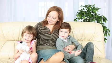 Family-Looking-At-Camera