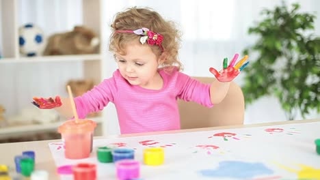 Girl-With-Hand-Painted-In-Colorful-Paints