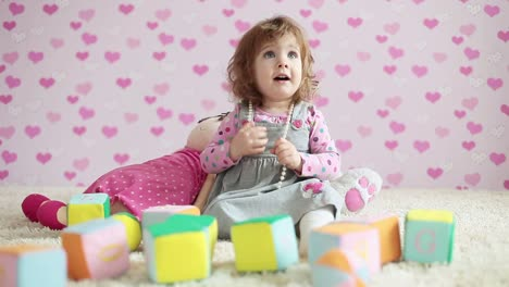 Happy-Baby-Girl-Playing-On-The-Carpet