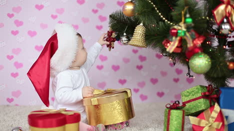 Happy-Baby-Near-A-Christmas-Tree-And-Gifts-Slow-Motion