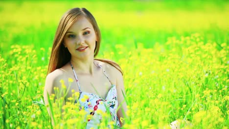 Happy-Teen-On-The-Meadow-With-Yellow-Flowers