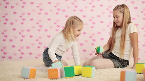 Happy-Two-Girls-Playing-In-The-Childrens-Room