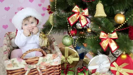 Hungry-Child-Is-Near-A-Christmas-Tree-And-Gifts