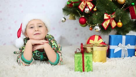 Laughing-Girl-Lying-Near-To-The-Christmas-Tree