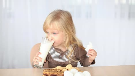 Little-Blonde-Drinking-Milk-At-The-Table