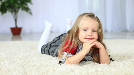 Little-Girl-Lying-On-The-Carpet-Looking-To-The-Camera-Dolly-HD