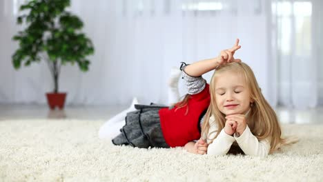 Sisters-Smiling-While-Lying-On-The-Carpet-Dolly-Hd