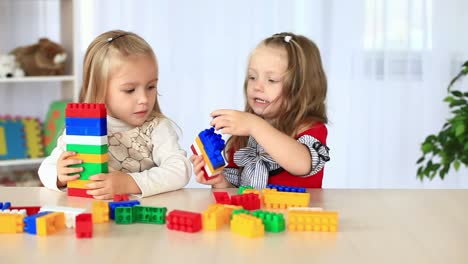 Two-Little-Sisters-Playing-With-The-Constructor-Dolly-Hd