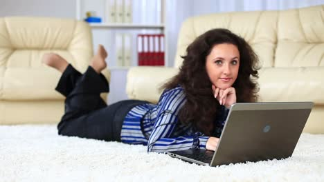 Young-Adult-With-Laptop-Lying-On-Carpet-She-Smiles-Dolly-Hd
