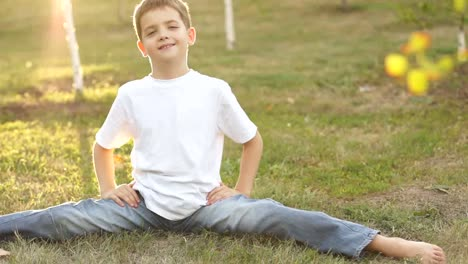 Boy-Is-Sitting-On-Twine-Outdoors