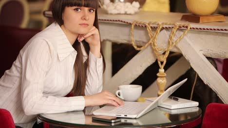 Businesswoman-Thinking-About-Something-And-Typing-On-Laptop