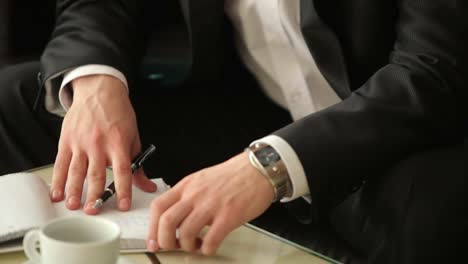 Businessman-At-Table-With-Documents