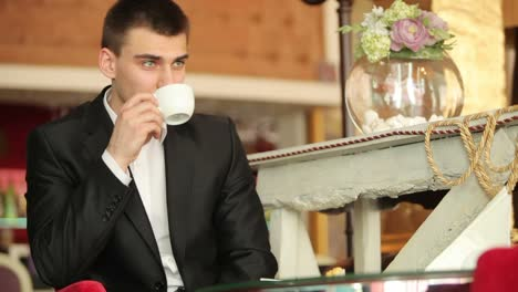 Businessman-Thinking-About-Something-And-Drinking-Coffee