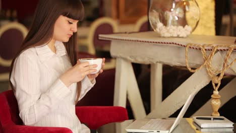 Businesswoman-Sitting-In-Cafe-And-Drinking-Coffee