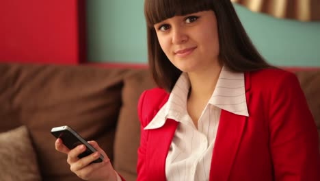 Businesswoman-With-Mobile-Phone-Closeup