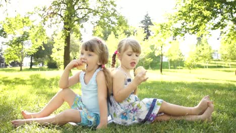 Children-Eating-Ice-Cream-Sitting-On-The-Grass