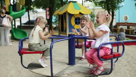Children-Wave-Their-Hands-On-The-Carousel-And-Clap-Their-Hands
