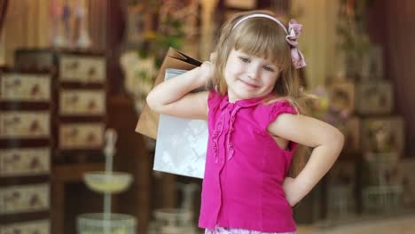 Closeup-Portrait-Of-A-Little-Girl-With-The-Packages-I-Love-Shopping-Little
