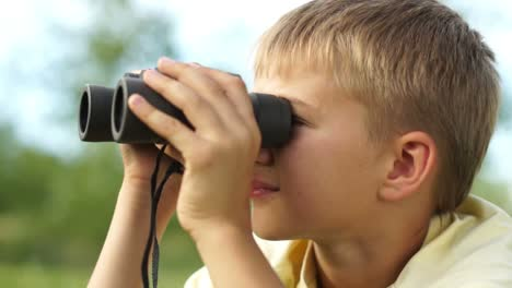 Closeup-Portrait-Of-A-Boy-Looking-Through-Binoculars