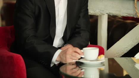 Closeup-Portrait-Of-A-Businessman-Drinking-Coffee-In-A-Cafe