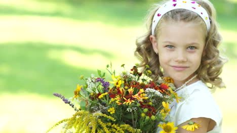 Closeup-Portrait-Of-A-Girl-With-Flowers-Looking-At-Camera
