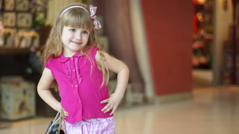Closeup-Portrait-Of-A-Little-Girl-Laughing-In-The-Shop
