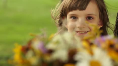 Girl-Gives-Viewers-A-Bouquet-Of-Wildflowers