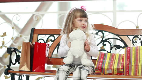 Girl-Hugging-A-Teddy-Bear-After-Shopping