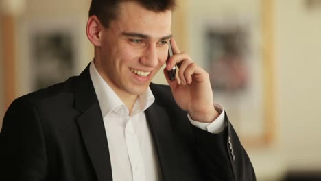 Guy-Talking-On-The-Phone-And-Laughing