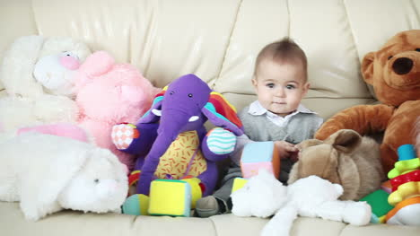 Happy-baby-boy-and-his-toys