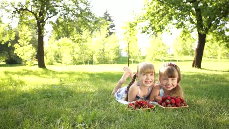 Laughing-Children-Lie-On-The-Grass-They-Eat-Strawberries