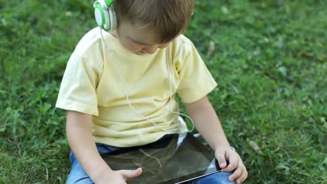 Little-Boy-Watching-A-Cartoon-With-A-Tablet-PC