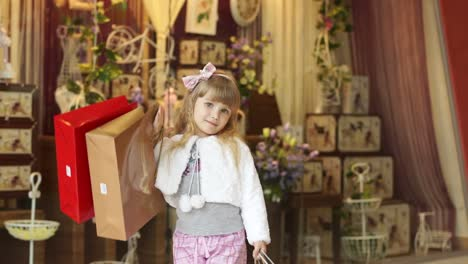 Little-Girl-In-The-Store-With-Their-Purchases
