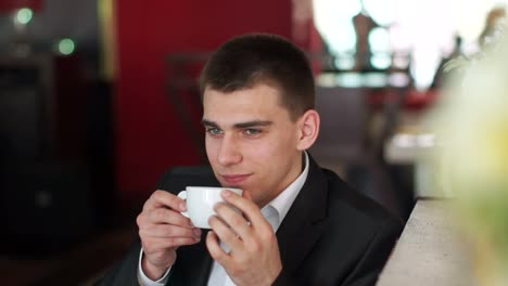 Man-Enjoying-Coffee-And-Thinking-About-Something