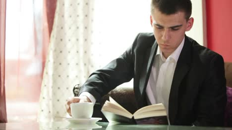 Man-Reading-And-Drinking-Coffee